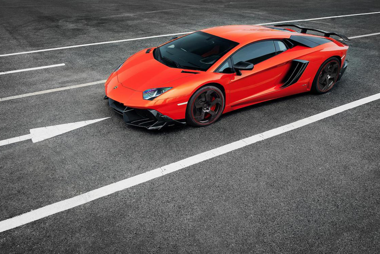 mansory aventador competition carbon fiber top front angle front bumper side skirt air intake fully forged wheel